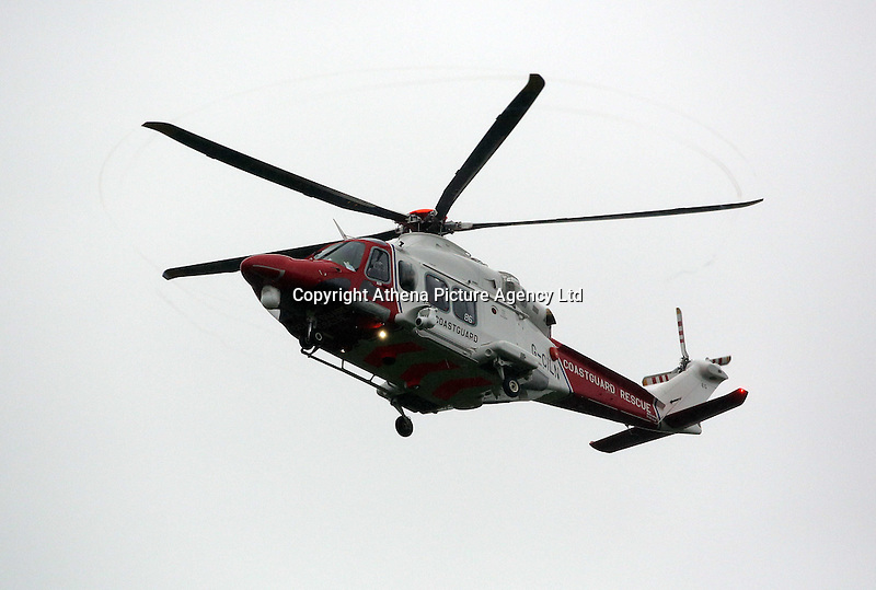 Pictured: A Coastguard helicopter approaches its landing site at Tafarn y Gerreg in Powys, Wales UK. Wednesday 29 June 2016<br />