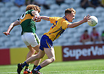 Darragh Connelly of Clare in action against Paul Walsh of Kerry during their Munster Minor football final at Pairc Ui Chaoimh. Photograph by John Kelly.