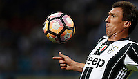 Calcio, Serie A: Inter vs Juventus. Milano, stadio San Siro, 18 settembre 2016.<br /> Juventus' Mario Mandzukic controls the ball during the Italian Serie A football match between FC Inter and Juventus at Milan's San Siro stadium, 18 September 2016.<br /> UPDATE IMAGES PRESS/Isabella Bonotto