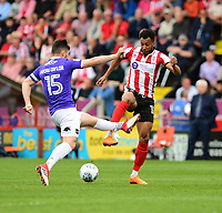 Lincoln City's Matt Green vies for possession with Exeter City's Jordan Moore-Taylor<br /> <br /> Photographer Chris Vaughan/CameraSport<br /> <br /> The EFL Sky Bet League Two Play Off First Leg - Lincoln City v Exeter City - Saturday 12th May 2018 - Sincil Bank - Lincoln<br /> <br /> World Copyright &copy; 2018 CameraSport. All rights reserved. 43 Linden Ave. Countesthorpe. Leicester. England. LE8 5PG - Tel: +44 (0) 116 277 4147 - admin@camerasport.com - www.camerasport.com
