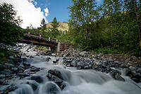 Crow Creek surges from the mountains on a beautiful summer day near Girdwood, Alaska.