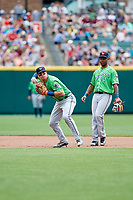 Gwinnett Stripers shortstop Tyler Smith (9) throws to first base in front of second baseman Danny Santana (15) during a game against the Columbus Clippers on May 17, 2018 at Huntington Park in Columbus, Ohio.  Gwinnett defeated Columbus 6-0.  (Mike Janes/Four Seam Images)