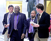 United States House Majority Whip James Clyburn (Democrat of South Carolina), left center, walks through Statuary Hall in the U.S. Capitol with aides and a reporter as he prepares to attend the press conference where U.S. House Democratic Leaders met reporters to announce the savings to the federal budget by their health care reform effort in the U.S. Capitol in Washington, D.C. on Thursday, March 18, 2010..Credit: Ron Sachs / CNP