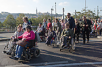 Participants of the Rehab Critical Mass demonstrate for better accessibility of disabled people in Budapest, Hungary on October 19, 2014. ATTILA VOLGYI