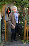 Pic shows: Jeremy Corbyn leaves his home in London today to visit Labour Party Conference in Brighton<br /> with his wife <br /> Laura Alvarez<br /> <br /> <br /> pic by Gavin Rodgers/ Pixel8000 Ltd
