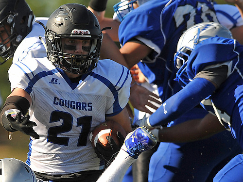 Alec Kiernan #21 of Centereach rushes up the middle for a 1-yard touchdown run during the third quarter of a Suffolk County Division II varsity football game against host Copiague High School on Saturday, Sept. 24, 2016. Centereach won by a score of 26-0.