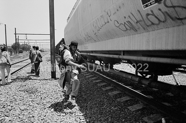 Ecatepec, Mexico<br /> Mexico<br /> June 4, 2007<br /> <br /> In the train station named Lecher&iacute;a , central and south Americans who had ventured north to Mexico City, mainly from Honduras, (but also from Guatemala and El Salvador),  jump the trains to take them north. Most of them had been traveling for one or two weeks. The train guards allowed them to travel and pointed out which train would take them to Monterrey where they could find a train to the USA border. Stories are abound of those killed while trying to jump the trains and police brutality.