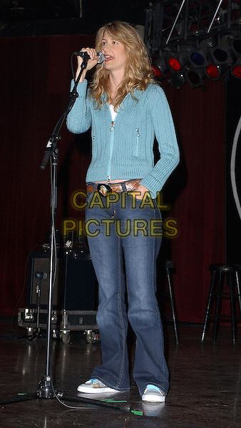 LAURA DERN.Rock for Choice Benefit Concert held at The Hollywood Palladium in Hollywood, California .23 January 2004       .*UK Sales Only*      .full length, full-length, denim jeans, blue cardigan, trainers                                     .www.capitalpictures.com.sales@capitalpictures.com.©Capital Pictures.
