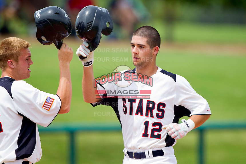 Chris Harvey #12 of STARS is congratulated by a teammate after hitting a home run against RBI at the 2011 Tournament of Stars at the USA Baseball National Training Center on June 26, 2011 in Cary, North Carolina. (Brian Westerholt/Four Seam Images)