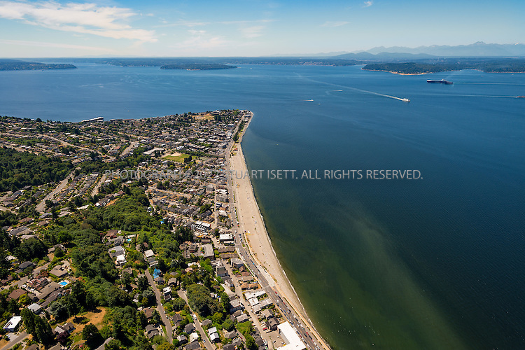 6/26/2015&mdash;Seattle, WA<br /> <br /> A view of Alki Beach in West Seattle.<br /> <br /> West Seattle comprises two of Seattle, Washington's thirteen districts, Delridge and Southwest, and encompasses all of Seattle west of the Duwamish River. It was incorporated as an independent town in 1902 and was annexed by Seattle in 1907. Among the area's attractions are its saltwater beach parks along Elliott Bay and Puget Sound, including Alki Beach Park and Lincoln Park. The area is also known for its views of the Olympic Mountains to the west and the Cascade Range to the east.<br /> <br /> Photograph by Stuart Isett<br /> &copy;2015 Stuart Isett. All rights reserved.
