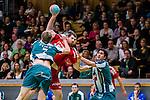 Stockholm 2013-11-10 Handboll Elitserien Hammarby IF - Eskilstuna Guif :  <br /> Eskilstuna Guif Alexander Stenb&auml;cken f&ouml;rs&ouml;ker ta sig f&ouml;rbi Hammarby 7 Patrik Lindblad och Hammarby 2 Jonatan Wenell <br /> (Foto: Kenta J&ouml;nsson) Nyckelord: