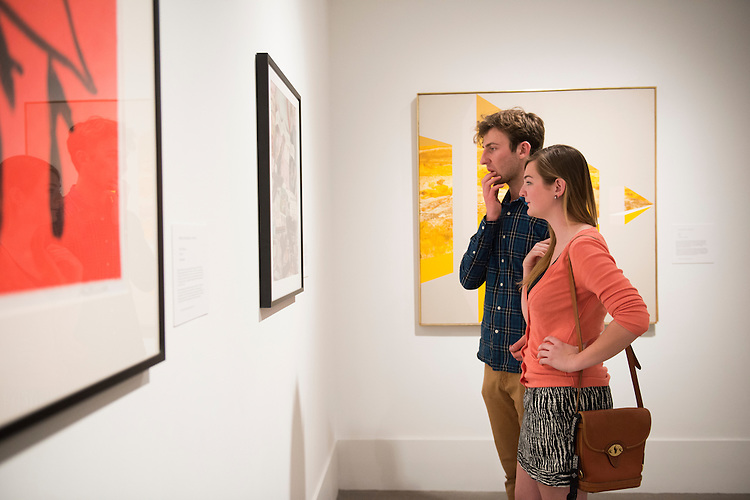 Hannah Meixner, a Junior in Geological Sciences, who participated in the Museum Studies Certificate program, examines art pieces of the Constructin Perspectives portion of the show at the Kennedy Museum of Art with her boyfriend Kevin Arseniseuz. Photo by Olivia Wallace