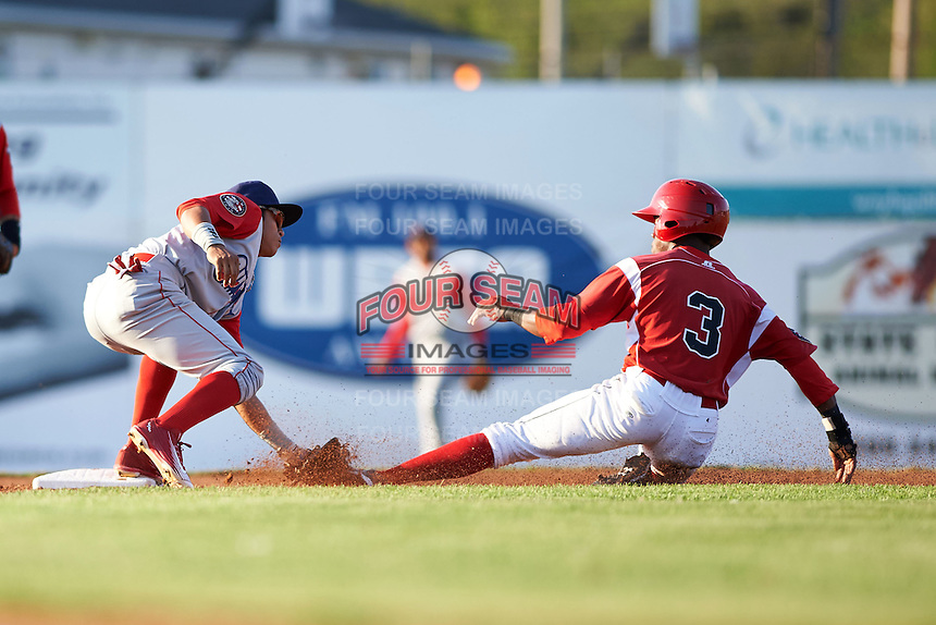Williamsport Crosscutters shortstop Grenny Cumana (2) tags out Anfernee Seymour (3) on a stolen base attempt during a game against the Batavia Muckdogs on July 15, 2015 at Dwyer Stadium in Batavia, New York.  Williamsport defeated Batavia 6-5.  (Mike Janes/Four Seam Images)