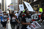 Demonstrators march up Dearborn Street to support a Citizens Police Accountability Council to provide civilian oversight of the Chicago Police Department in Chicago, Illinois on July 11, 2016.  The demonstration attracted a larger crowd on the heels of last week's racially charged police shootings captured on video of Alton Sterling in Baton Rouge, Louisiana and Philando Castile in the St. Paul suburb of Falcon Heights, Minnesota which was followed by a mass shooting of five police officers by Afghan War veteran Micah Johnson who supported radical and violent black nationalist ideology.