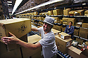 Andrew Sassone fills orders at the Eagle Creek warehouse at their company headquarters in Vista, California, in April, 2009.  for the North County Times