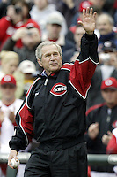03 April 2006: President Bush waves to the crowd as he approaches the mound to throw out the ceremonial first pitch before the start of the Cincinnati Reds' home opener against the Chicago Cubs at Great American Ballpark in Cincinnati, Ohio.<br />