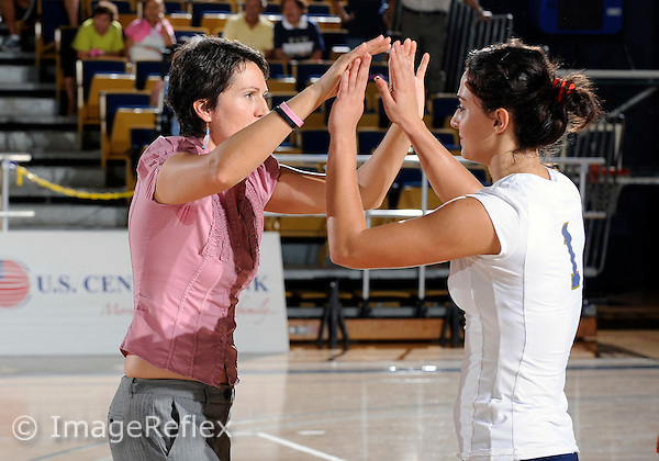 Florida International University women's volleyball player Andrea Lakovic (1) and Head Coach Danijela Tomic celebrate after the game against the University of Arkansas at Little Rock.  FIU won the match 3-2 on October 23, 2009 at Miami, Florida. .