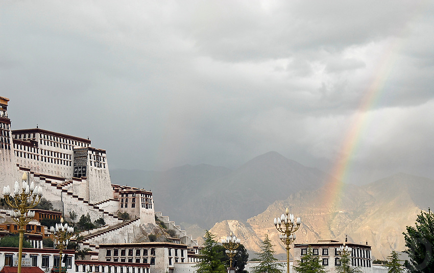 The Potala Palace in Lhasa, Tibet Autonomous Region was the residence of the Dalai Lama until the 14th Dalai Lama fled to India during the 1959 Tibetan uprising. It is now a museum and World Heritage Site. Rainstorm and Rainbow.