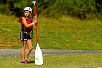 Young outdoor enthusiasts learn the art of whitewater kayaking during a summer camp session at the US National Whitewater Center (USNWC) in Charlotte NC. The USNWC is home to one of the world's largest manmade recirculating whitewater courses.