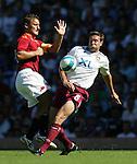 West Ham's Matthew Upson tackles Roma's Francesco Totti. .Pic SPORTIMAGE/David Klein
