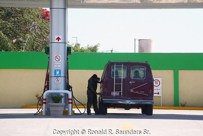 Attendant fills gas in van<br /> (3)