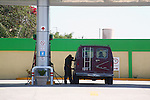 Attendant fills gas in van<br />