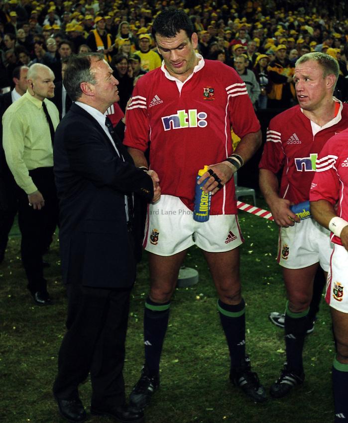Photo. Richard Lane. .Australia v Bristish and Irish Lions. Lions Tour 2001 to Australia. Third Test at the Stadium Australia, Sydney, Australia. 14/7/2001..Lions coach, Graham Henry shakes hands with his captain, Martin Johnson.