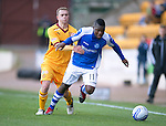 St Johnstone v Motherwell...03.11.12      SPL.Nicky Law gets a hold of Nigel Hasselbaink.Picture by Graeme Hart..Copyright Perthshire Picture Agency.Tel: 01738 623350  Mobile: 07990 594431