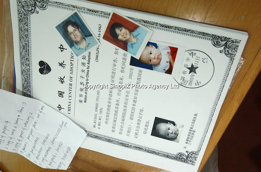 Adoption papers in the room. This family were part of a group of Canadian nationals go through the adoption procedure in Changsha, Hunan, China.