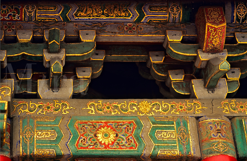 China. Xi'an. Painted roof timbers in ancient Buddhist temple.
