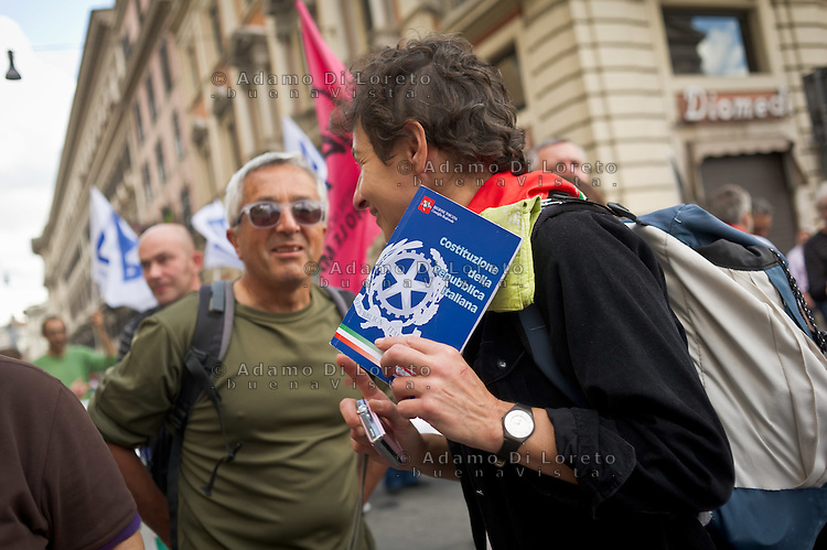 ITA: Una donna stringe tra le mani il libro della costituzione italiana. Roma 13 Ottobre 2013, Manifestazione in difesa della Costituzione italiana. Il corteo sflia per le strade del centro della capitale.                ENG: A woman holding the italian costitution. Rome October 12, 2013 during a protest of center-left and trade unionionists to defend the Italian Constitution. (Photo credit Adamo Di Loreto)