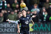 17th March 2019, Dens Park, Dundee, Scotland; Ladbrokes Premiership football, Dundee versus Celtic; John O'Sullivan of Dundee competes in the air with Callum McGregor of Celtic