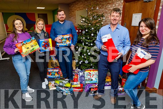 The staff of Sigmar Recruitment in Liber House, Monavalley donate to to the St Vincent de Paul's Junior Locke at their offices on Friday.<br /> on Friday<br /> L to r:  Junior Locke (St Vincent de Paul) and Nadia Woods (Sigmar Recruitment).<br /> Back l to r: Aisling O'Donovan, Roisin Hamill and Brendan Caulfield.