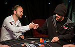 Team Pokerstars Pro Daniel Negreanu bumps fists with Phil Laak after being eliminated by Laak.