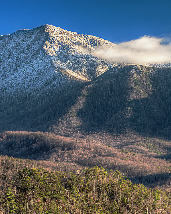 Mount Leconte is veiled by a blanket of snow on a clear November day. HDR image.