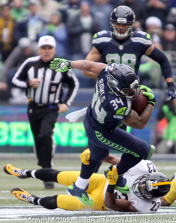 Seattle Seahawks running back Thomas Rawls (34) is tackled by  Pittsburgh Steelers  safety Mike Mitchell (23) at CenturyLink Field in Seattle, Washington on November 29, 2015.  The Seahawks beat the Steelers 39-30.      ©2015. Jim Bryant Photo. All Rights Reserved.