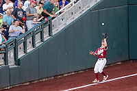 Indiana Hoosiers pinch hitter Chris Sujka (4) makes a catch against the Oregon State Beavers during Game 9 of the 2013 Men's College World Series  on June 19, 2013 at TD Ameritrade Park in Omaha, Nebraska. The Beavers defeated the Hoosiers 1-0, eliminating Indiana from the tournament. (Andrew Woolley/Four Seam Images)