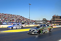 Jul. 28, 2013; Sonoma, CA, USA: NHRA funny car driver Alexis DeJoria (near lane) races alongside Robert Hight during the Sonoma Nationals at Sonoma Raceway. Mandatory Credit: Mark J. Rebilas-