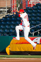 Alex Castellanos (18) of the Springfield Cardinals jumps over the right field foul line during a game against the Tulsa Drillers at Hammons Field on July 20, 2011 in Springfield, Missouri. Springfield defeated Tulsa 12-1. (David Welker / Four Seam Images)