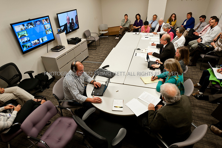 1/25/2012--Seattle, WA, USA..Dr. Tauben (center of table, leaning forward) leads a Project Echo UW Pain Televideo session at University of Washington's Division of Pain Medicine in Seattle, WASH. The video conferences are designed to reach out to regional doctors to discus pain management for patients...Washington State has developed new regulations meant to stop doctors from prescribing higher doses of powerful and often dangerous pain killers for patients who are not benefiting from them. Nationwide, fatalities from prescription drug overdoses are the second-leading cause of accidental death behind car accidents and, in some states, are the leading cause...©2012 Stuart Isett. All rights reserved.