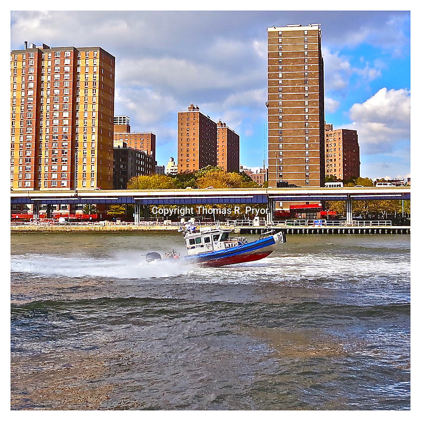 NEW YORK, NY - OCTOBER 18: Police boat rushing up the East River on the Lower East Side in New York, New York on October 18, 2012. Photo Credit: Thomas R Pryor