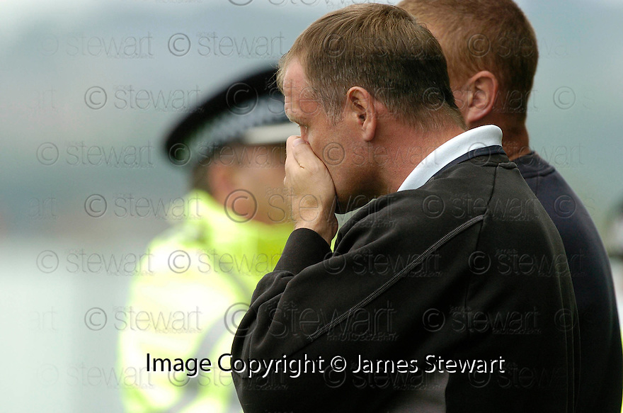 16/09/2006        Copyright Pic: James Stewart.File Name : sct_jspa20_falkirk_v_aberdeen.FALKIRK MANAGER JOHN HUGHES CAN'T BEAR TO WATCH HIS TEAM GET BEAT AGAIN.....Payments to :.James Stewart Photo Agency 19 Carronlea Drive, Falkirk. FK2 8DN      Vat Reg No. 607 6932 25.Office     : +44 (0)1324 570906     .Mobile   : +44 (0)7721 416997.Fax         : +44 (0)1324 570906.E-mail  :  jim@jspa.co.uk.If you require further information then contact Jim Stewart on any of the numbers above.........