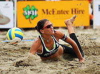 Anna Scarlett lands heavily diving for the ball during the 2009 McEntee Hire NZ Beach Volleyball Tour - Women's final at Oriental Parade, Wellington, New Zealand on Sunday, 11 January 2009. Photo: Dave Lintott / lintottphoto.co.nz.