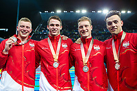 Picture by Alex Whitehead/SWpix.com - 10/04/2018 - Commonwealth Games - Swimming - Optus Aquatics Centre, Gold Coast, Australia - Adam Peaty, Ben Proud, Luke Greenbank and James Guy of England win Silver in the Men's 4x100m Medley Relay.