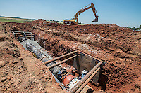 NWA Democrat-Gazette/ANTHONY REYES &bull; @NWATONYR<br /> A crew with the Fayetteville Water and Sewer department replace 60-70 feet of a 42-inch water line Friday, August 14, 2015 in a field south of Frisco Church Road in Lowell. A power outage led to the leak and shut down the line. A 36-inch water line is still supplying water but citizens in Fayetteville, West Fork, Greenland, Mount Olive, Farmington and parts of Johnson are being asked to conserve water until full service can be restored.