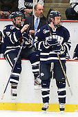 Brett Kostolansky (UNH - 15), Scott Borek (UNH - Associate Head Coach), Connor Hardowa (UNH - 2) - The Harvard University Crimson defeated the University of New Hampshire Wildcats 7-6 on Tuesday, November 22, 2011, at Bright Hockey Center in Cambridge, Massachusetts.