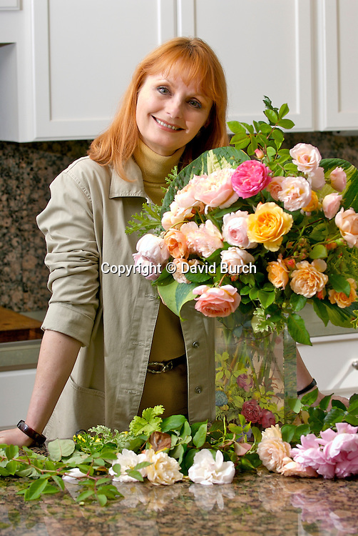 Mature woman with flower arrangement