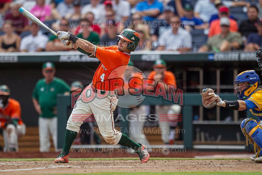 Miami Hurricanes second baseman Johnny Ruiz (4) swings the bat against the UC Santa Barbara Gauchos in Game 5 of the NCAA College World Series on June 20, 2016 at TD Ameritrade Park in Omaha, Nebraska. UC Santa Barbara defeated Miami  5-3. (Andrew Woolley/Four Seam Images)