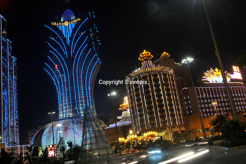 "Casinos light up the main boulevard and centre of Macau, 25th October 2008.  Macau is known simply as ""Vegas"" in China. The former Potuguese colony, now a Chinese Special Administrative Region, attracts millions of Chinese gamblers annually and last year earned more gambling dollars than Las Vegas."