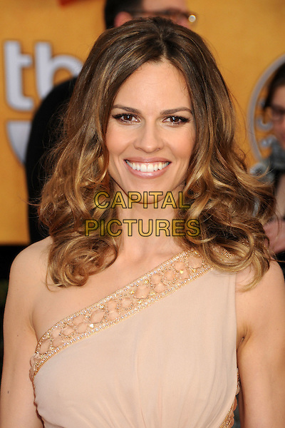 HILARY SWANK.17th Annual Screen Actors Guild Awards held at The Shrine Auditorium, Los Angeles, California, USA..January 30th, 2011.SAG headshot portrait beige gold one shoulder beads beaded.CAP/ADM/BP.©Byron Purvis/AdMedia/Capital Pictures.